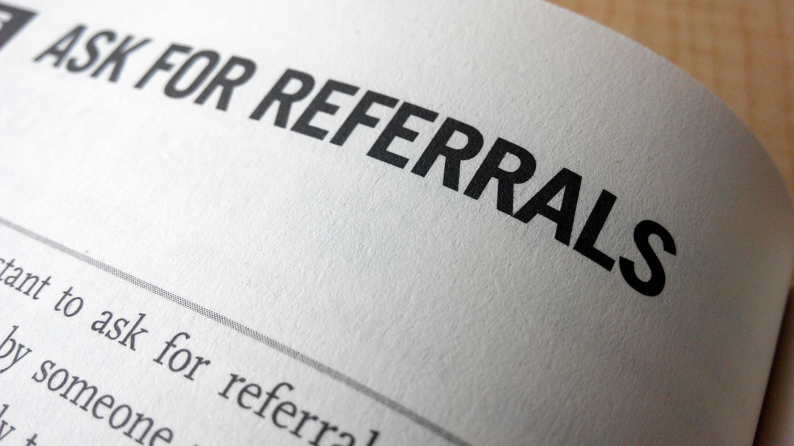 Ask For Referrals Word On A Book